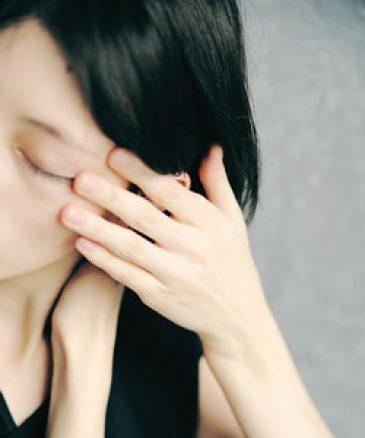 sad woman holding her hair